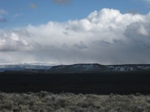 Jackass Mountain rises high above Harney Basin with snowy Steens Mountain in the background
